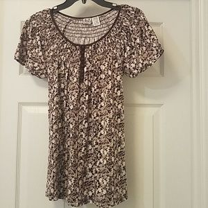 Brown and cream colored maternity top